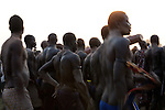 Sunday 5 december 2010 - Juba, Southern Sudan - Mundari wrestlers team celebrates their victory after a traditional wrestling match in Juba Stadium between Dinka wrestlers from Yirol East of Lake State and the Mundari wrestlers from Terekeka County of Central Equatoria State. The matches attracted large numbers of spectators who sang, played drums and danced in support of their favorite wrestlers. The match organizers hoped that the sport would bring together South Sudan's many different tribes. Photo credit: Benedicte Desrus
