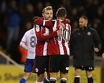 Harry Chapman of Sheffield Utd enjoys the win with Billy Sharp of Sheffield Utd during the English League One match at the Bramall Lane Stadium, Sheffield. Picture date: November 22nd, 2016. Pic Simon Bellis/Sportimage