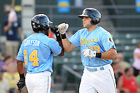 Catcher Vincent DiFazio (29) of the Myrtle Beach Pelicans is congratulated by Chris Grayson (14) after hitting a home run in a game against the Frederick Keys on August 4, 2012, at TicketReturn.Com Field in Myrtle Beach, South Carolina. Myrtle Beach won, 4-3. (Tom Priddy/Four Seam Images)