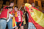 Spanish tourists in Rome celebrate after their National Team won the World Football Cup on July 11, 2010.