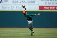 Greensboro Grasshoppers shortstop Ji-Hwan Bae (51) catches a fly ball in shallow left field during the game against the Hickory Crawdads at L.P. Frans Stadium on May 26, 2019 in Hickory, North Carolina. The Crawdads defeated the Grasshoppers 10-8. (Brian Westerholt/Four Seam Images)