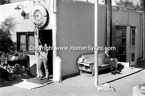 Woman leaving motel. Calico California USA  1971