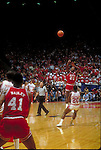 04 APR 1983:  Dereck Whittenburg (25) of North Carolina State puts up a last second shot over Alvin Franklin (20) of Houston during the Men's Final Four Championship held in Albuquerque, NM at the University of New Mexico Pit.  North Carolina State defeated Houston 54-52 for the national title.  (this is the shot which was caught by Lorenzo Charles and put in at the buzzer for the win)  Photo Copyright Rich Clarkson