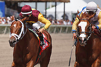 Travelin Man(left) with John Velazquez up outduel Jersey Town (right) ridden by Edgar Prado battle to the wire in the Sir Shackleton Stakes. Gulfstream Park Hallandale Beach Florida. 03-31-2012