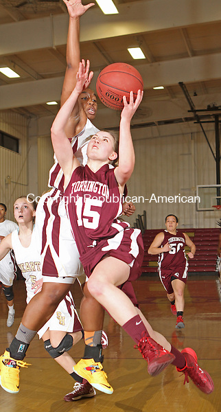 WATERBURY, CT-25 January 012514MK17 Torrington's Caroline Teti (15) drives to the hoop as Sacred Heart's Maya Eggleston (42)  defends during NVL girl's basketball action Saturday evening at Sacred Heart High School.  Sacred Heart defeated Torrington 50-42. Michael Kabelka / Republican-American