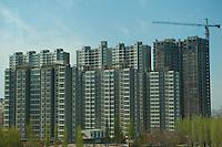Daytime landscape view from a bus of a residential housing complex under construction in Dàtóng Shì Chéng Qū in Shānxī Province, China  © LAN
