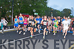 The runners take to the road at the start of the Feet first road race in Killarney on Friday night..