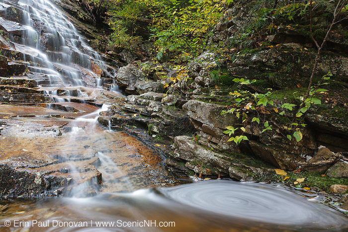 Silver Cascade in Hart's Location, New Hampshire during the autumn months. This waterfall is roadside along Route 302 in Crawford Notch State Park, and it is a big tourist attraction.