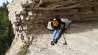 NWA Democrat-Gazette/FLIP PUTTHOFF <br /> Thao Nguyen wiggles through a hole in the rock Nov. 18 2016 during a Goat Trail hike.