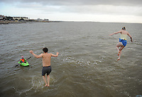 25/12/2013.Simmers Jump from the diving tower in Blackrock Ireland. During the Christmas Day Swim at Salthill, Galway