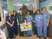 Pictured: Elly Neville (C) with Withybush Hospital staff<br /> Re: Seven-year-old Elly Neville who was born despite doctors saying her parents would not be able to have any more children, has raised over &pound;150,000 for the cancer ward that treated her father.<br /> Her parents Lyn and Ann had been told they were unlikely to have more children after he underwent a bone marrow transplant in 2005. <br /> Mr Neville subsequently spent a lot of time on the Ward 10 cancer facility at Withybush Hospital in Haverfordwest, Pembrokeshire.<br /> But four years later they were stunned when his painter and decorator wife Ann fell pregnant again.