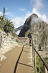 Hiker taking in the ruins of Machu Picchu, Peru.