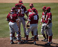 LOS ANGELES, CA - April 10, 2011: The Stanford baseball infield meet at the mound during Stanford's game against USC at Dedeaux Field in Los Angeles. Stanford lost 6-2.