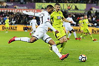 Luciano Narsingh of Swansea City (L) crosses the ball during The Emirates FA Cup match between Swansea City and Notts County at The Liberty Stadium, Swansea, Wales, UK. Tuesday 06 February 2018