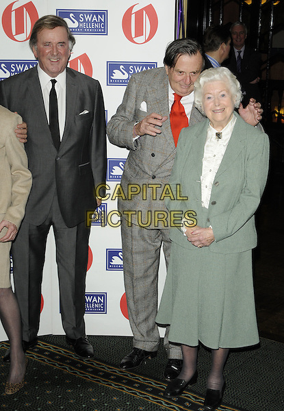 SIR TERRY WOGAN, BARRY HUMPHRIES & JUNE SPENCER.The Oldie Of The Year Awards at Simpsons On The Strand, London, England..February 10th, 2011.full length black white grey gray tie suit red ruffle blouse green jacket skirt hands .CAP/CAN.©Can Nguyen/Capital Pictures.