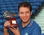 Ally McCoist collects the Bell's player of the month award for August 1998