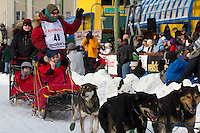 2010 Iditarod Ceremonial Start in Anchorage Alaska musher # 48 GERALD SOUSA with Iditarider PATRICIA KENNEDY