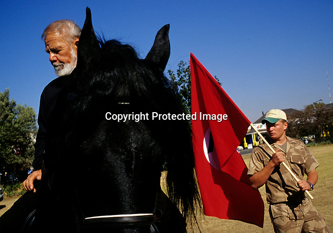 POTCHEFSTROM, SOUTH AFRICA - JUNE 12: .Eugene Terre Blanche, the leader of AWB, a right wing movement, on his horse on June 12, 2004 in central Potchefstrom, South Africa. Mr. Terre Blanche was released from prison earlier in the day. Mr. Terre Blanche served five years for assaulting a black man. The AWB movement tried to disrupt the first democratic election in the country in 1994. A series of bombs and attacks were blamed on AWB members leading up to Election Day. .(Photo: Per-Anders Pettersson/Getty Images).