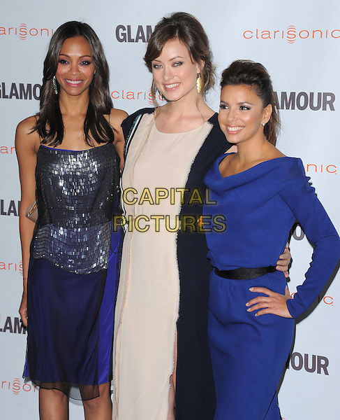 Zoe Saldana, Olivia Wilde and Eva Longoria  .The Glamour Reel Moments held at The Directors Guild of America in West Hollywood, California, USA..October 24th, 2011.half length dress blue black belt shoes hand on hip blue silver white cream .CAP/RKE/DVS.©DVS/RockinExposures/Capital Pictures.