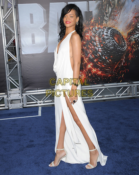 Rihanna (Robyn Rihanna Fenty).Premiere of 'Battleship' held at Nokia Theatre L.A. Live in Los Angeles, California, USA..May 10th, 2012.full length white dress halterneck slit split cowl neck plunging neckline side.CAP/RKE/DVS.©DVS/RockinExposures/Capital Pictures.
