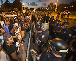 BATON ROUGE, LA -JULY 08:  Protesters face off with Baton Rouge police in riot gear across the street from the police department over the Alton Sterling shooting in Baton Rouge, Louisiana July 8, 2016.  Sterling was shot and killed by police on July 5, 2016 in Baton Rouge, Louisiana. (Photo by Mark Wallheiser/Getty Images)