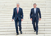 Chief Justice of the United States John G. Roberts, Jr. and Associate Justice Neil M. Gorsuch walk down the front steps of the US Supreme Court Building as they pose for photos after the investiture ceremony for Justice Gorsuch in Washington, DC on Thursday, June 15, 2017. <br /> Credit: Ron Sachs / CNP