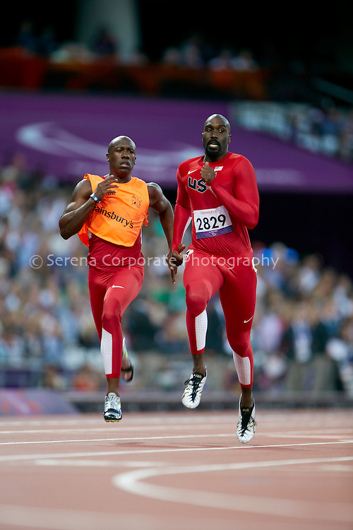 USA's Josiah Jamison and his guide Jerome Avery finish the semi final of the men's T12 200m, but was unfortunatley disqualified. .London Paralympic Games - Athletics 7.9.12