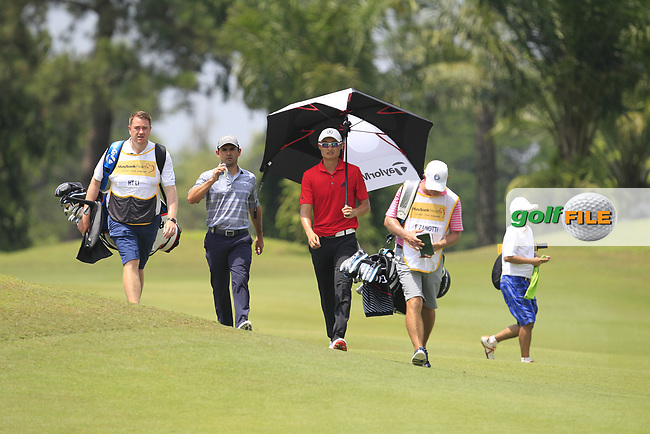 Fabrizio Zanotti (PAR) and Haotong Ji (CHN) walking down the 2nd fairway during Round 1 of the Maybank Championship at the Saujana Golf and Country Club in Kuala Lumpur on Thursday 1st February 2018.<br /> Picture:  Thos Caffrey / www.golffile.ie<br /> <br /> All photo usage must carry mandatory copyright credit (© Golffile | Thos Caffrey)