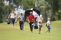 Fabrizio Zanotti (PAR) and Haotong Ji (CHN) walking down the 2nd fairway during Round 1 of the Maybank Championship at the Saujana Golf and Country Club in Kuala Lumpur on Thursday 1st February 2018.<br /> Picture:  Thos Caffrey / www.golffile.ie<br /> <br /> All photo usage must carry mandatory copyright credit (&copy; Golffile | Thos Caffrey)