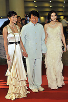 """HONG KONG - MARCH 22:  Hong Kong actor Jackie Chan (C) and Chinese actresses Fan Bingbing (R) and Xu Jingle attend the Opening Ceremony of the 33rd Hong Kong International Film Festival and the Gala Premiere of the opening films """"Shinjuku Incident """" at the Hong Kong Convention and Exhibition Centre on March 22, 2009 in Hong Kong.  Photo by Victor Fraile / studioEAST"""