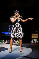 "Chi T. Mathias, a professional vocalist, songwriter and recording artist performing at  ""Walk In Her Shoes - Designer Shoe Fashion and Trunk Show 2009"" event organized by Every Step Counts at Mildred Bastian Centre for Performing Arts Theater of Forest Park Community College, 5600 Oakland Ave, St. Louis, Missouri on Apr 11, 2009."