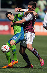 Seattle Sounders' Marco Pappa, left, is guarded by Colorado Rapids' Shane O'Neill during an MLS match on April 26, 2014 in Seattle, Washington.  The Seattle Sounders beat the Colorado Rapids 4-1.  Jim Bryant Photo. ©2014. All Rights Reserved.