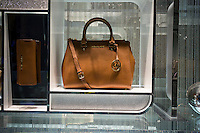 A Michael Kors bag in the window of the brand's store in the Time Warner Center in New York on Sunday, January 4, 2015. Shares of Michael Kors fell 8.4 percent after Credit Suisse cut the rating on the stock citing slowing handbag demand. (© Richard B. Levine)