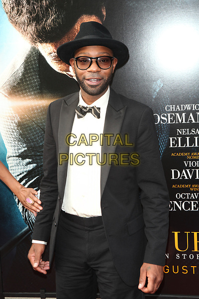 ***FILE PHOTO*** NEW YORK, NY - JULY 21: Nelsan Ellis at the New York Premiere of 'Get On Up' at The Apollo Theater in New York City on July 21, 2014.<br /> CAP/MPI99<br /> &copy;MPI99/Capital Pictures