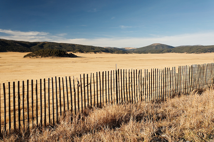 A fence line at the edge of the Valle Grande caldera, Valles Caldera National Preserve, New Mexico, USA