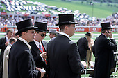 Racegoers in front of the Queen's Stand at Epsom Downs racecourse on Derby Day.