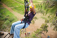 Woman preparing to rapell while ziplining