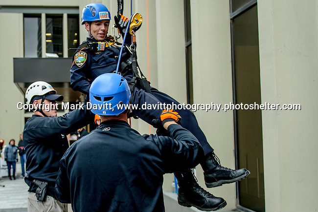 Captain Kramer gets a little helping hand as she nears the ground below the 345-ft. Financial Center in Des Moines.