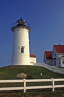 Lighthouse, Cape Cod, Falmouth, Massachusetts, The white Nobska Lighthouse sits on top of hill.