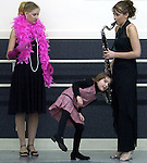 Nora Harstford, 6, gets an earful as 2006 Miss Green Bay Area contestant Tara Hellman, right, practices her bass clarinet routine near fellow contestant Megan LeCaptain in January of 2006 at Barb's Centre For Dance in Green Bay.