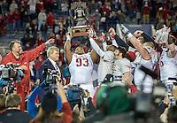 NWA Democrat-Gazette/JASON IVESTER <br /> Arkansas vs Kansas St, Liberty Bowl<br /> Arkansas defensive lineman DeMarcus Hodge (93) lifts the Liberty Bowl trophy following the game on Saturday, Jan. 2, 2016, at the Liberty Bowl in Memphis, Tenn.