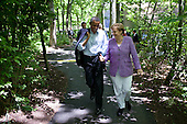 United States President Barack Obama talks with Chancellor Angela Merkel of Germany as they walk from Laurel Cabin to Aspen Cabin during the G8 Summit at Camp David, Md., May 19, 2012. .Mandatory Credit: Pete Souza - White House via CNP