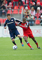 22 October 2011: New England Revolution forward Milton Caraglio #9 and Toronto FC defender Andy Iro #3 in action during a game between the New England Revolution and Toronto FC at BMO Field in Toronto.