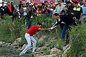 QUIROS Alvaro (ESP) is helped out of the lake adjacent to the 18th green after jumping into the water to celebrate winning during the final round of the Commercialbank Qatar Masters Presented by Dolphin Energy played at Doha Golf Club on 22nd January 2009 in Doha, Qatar. Picture Credit / Phil Inglis