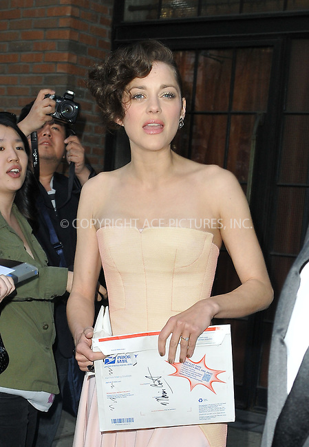 WWW.ACEPIXS.COM......May 6 2013, New York City....Actress Marion Cotillard leaves a downtown hotel on the way to the Met Gala on May 6 2013 in New York City....By Line: Romeo/ACE Pictures......ACE Pictures, Inc...tel: 646 769 0430..Email: info@acepixs.com..www.acepixs.com