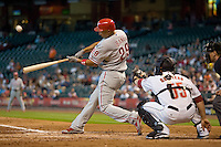 Philadelphia Phillies outfielder Raul Ibanez #29 swings during the Major League Baseball game against the Houston Astros at Minute Maid Park in Houston, Texas on September 14, 2011. Philadelphia defeated Houston 1-0 to clinch a playoff berth.  (Andrew Woolley/Four Seam Images)