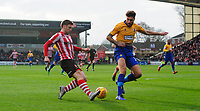 Lincoln City's Shay McCartan crosses the ball despite the attentions of Mansfield Town's Ryan Sweeney<br /> <br /> Photographer Chris Vaughan/CameraSport<br /> <br /> The EFL Sky Bet League Two - Lincoln City v Mansfield Town - Saturday 24th November 2018 - Sincil Bank - Lincoln<br /> <br /> World Copyright &copy; 2018 CameraSport. All rights reserved. 43 Linden Ave. Countesthorpe. Leicester. England. LE8 5PG - Tel: +44 (0) 116 277 4147 - admin@camerasport.com - www.camerasport.com