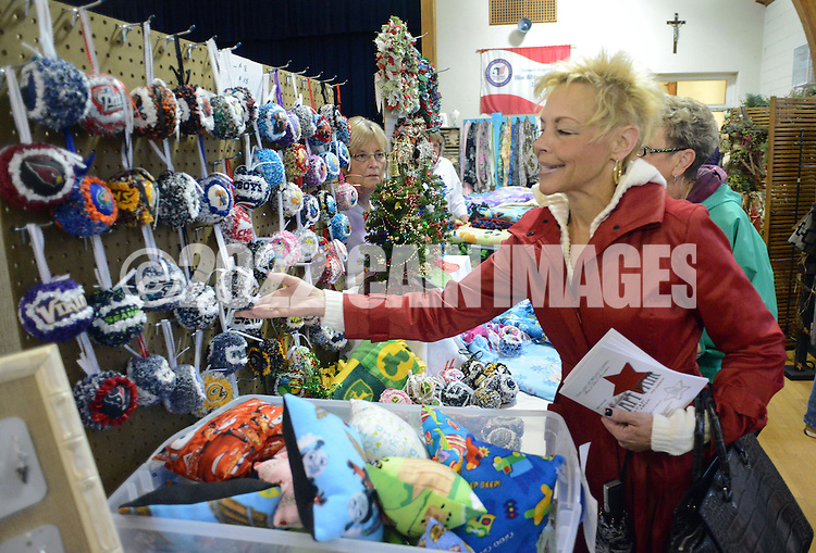 DOYLESTOWN, PA - NOVEMBER 1: Karen Malandra of Doylestown, Pennsylvania browses sports themed Christmas ornaments at the Our Lady of Mount Carmel Holiday Craft Fair  November 1, 2014 in Doylestown, Pennsylvania. Proceeds from this fundraising event will benefit Our Lady of Mount Carmel School. (Photo by William Thomas Cain/Cain Images)