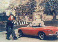 BNPS.co.uk (01202 558833)<br /> Pic: Dukes/BNPS<br /> <br /> MG B Roadster pictured in stills from the film, Sleuth which starred starring Laurence Olivier and Micheal Caine (PICTURED AS A CLOWN). The car sold for £8000<br /> <br /> The contents of one of England's finest stately homes are expected to fetch over £1m when they go under the hammer.<br /> <br /> The auction of a myriad of treasures inside Athelhampton House in Dorset is being hailed as one of the best country house sales for a generation <br /> <br /> The collection of fine art, furniture, sculptures, paintings and rugs has been amassed by three generations of the Cooke family who have just sold the Tudor mansion for £7.5m.