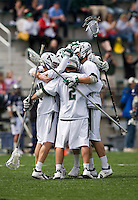 Steve Layne (2) embraces his Loyola teammates after winning the game at the Ridley Athletic Complex in Baltimore, MD.  Loyola defeated Georgetown, 11-6.